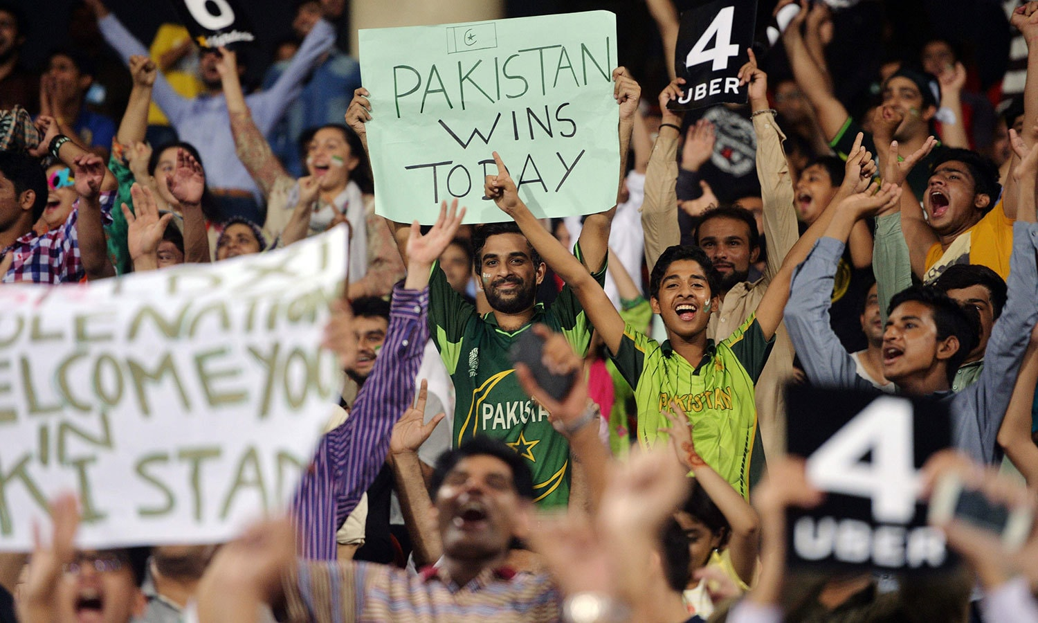 Spectators cheer at the start of the first Twenty20 international match between the World XI and Pakistan. —AFP