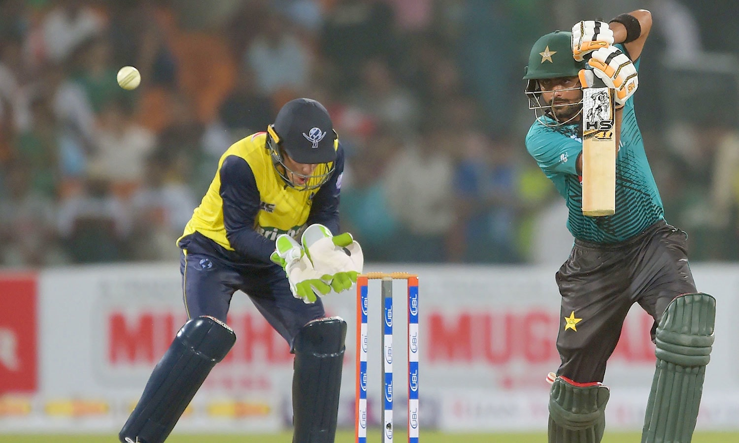 Pakistan opener Ahmed Shehzad plays a shot as World XI wicket-keeper Tim Paine looks on. —AFP
