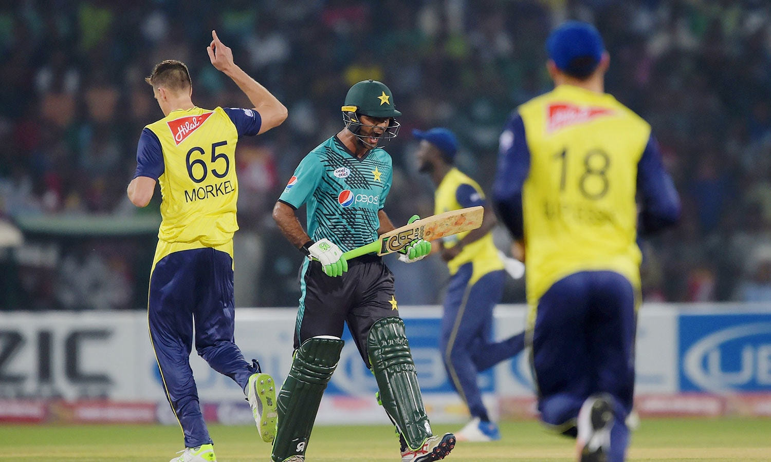 World XI players celebrate as Fakhar Zaman leaves the pitch. — AFP