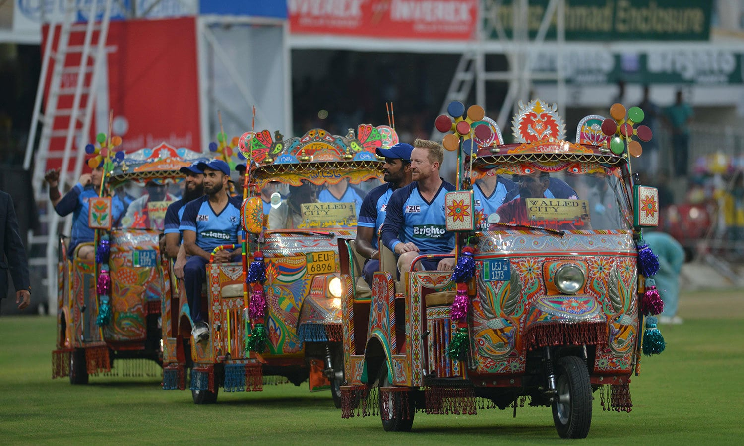 World XI players arrive on the pitch in rickshaws painted with truck art at Gaddafi Stadium. —AFP