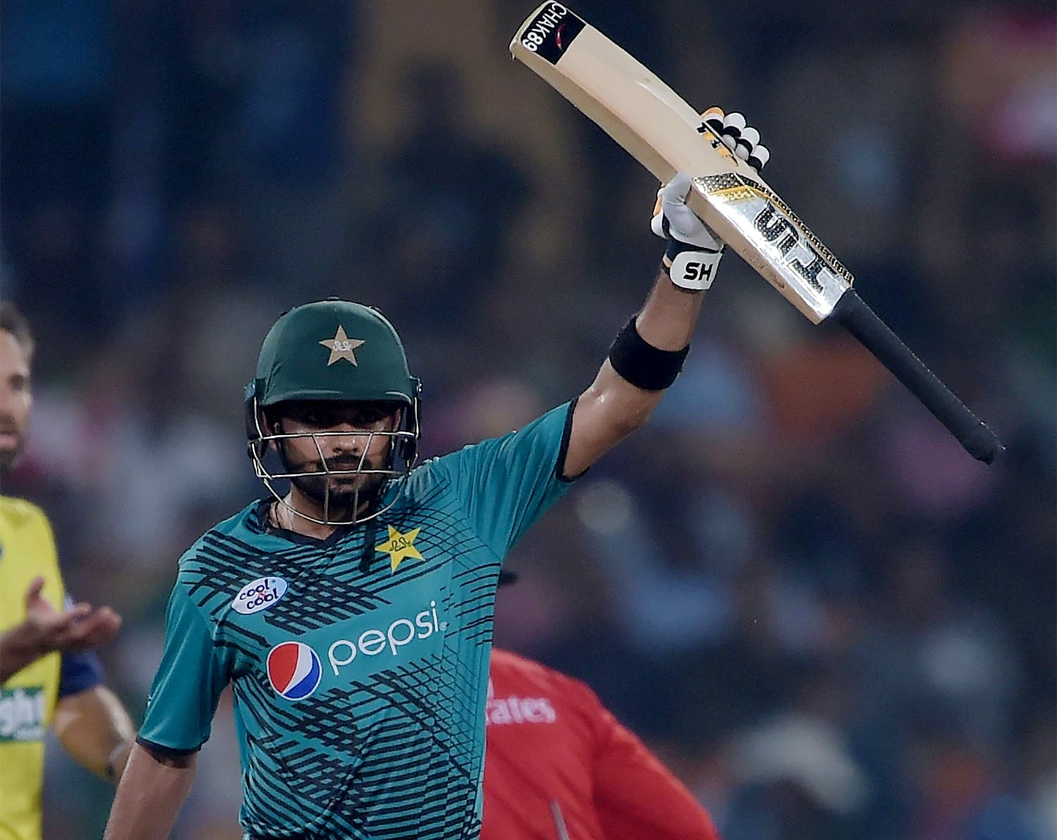 Babar Azam celebrates after scoring 50 runs during the first T20I between the World XI and Pakistan. ─ AFP