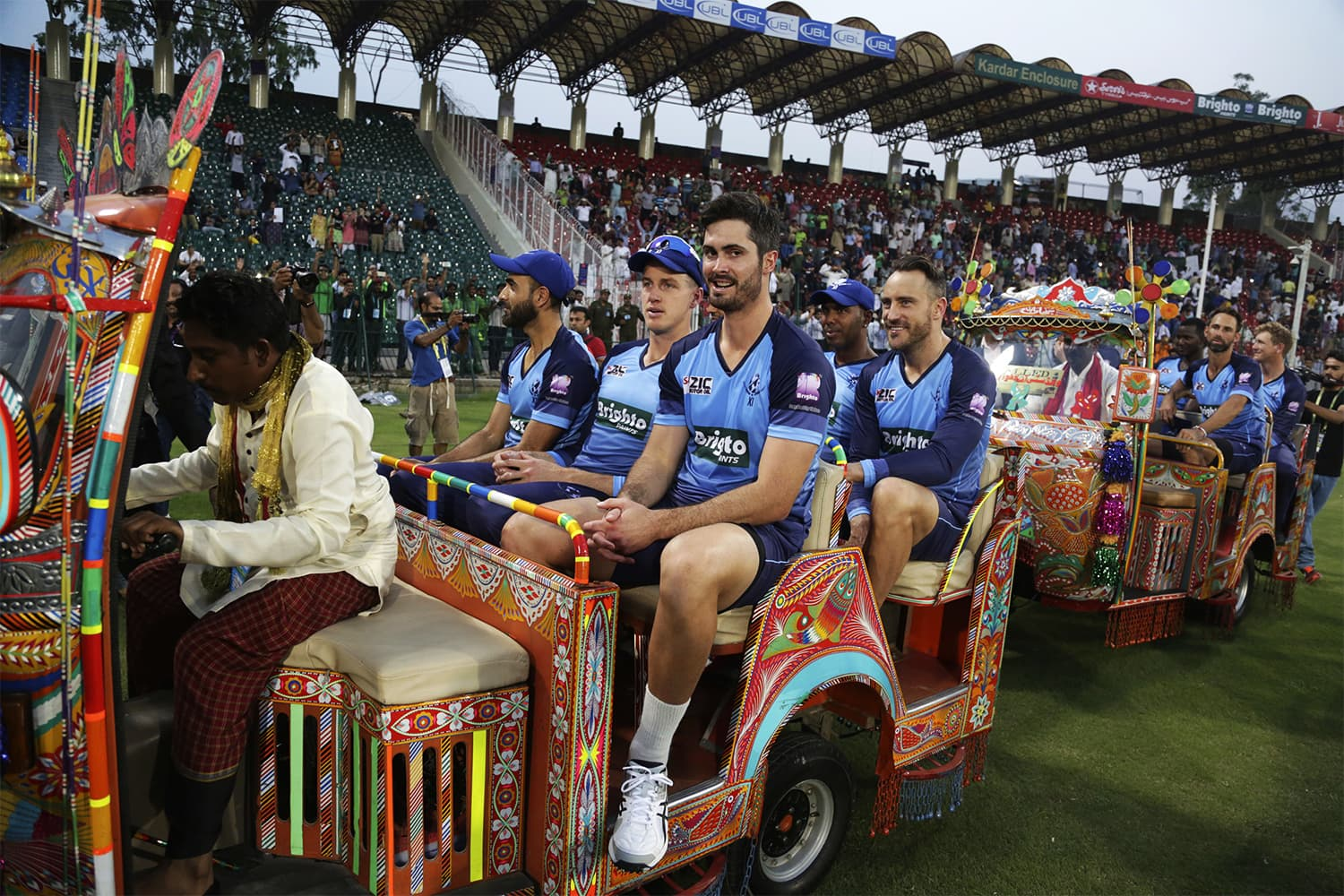 Members of the World XI team ride in traditional rickshaws before the start of the first match of the Independence Cup series between the World XI team and Pakistan in Lahore. ─ AP