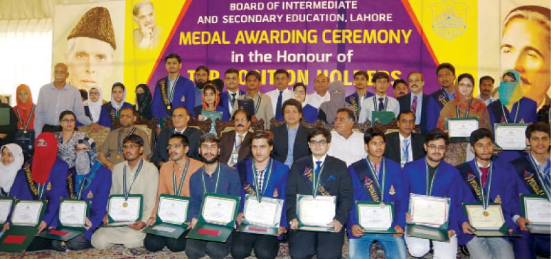 Position holders in intermediate exams with Punjab Higher Education Minister Raza Ali Gilani.