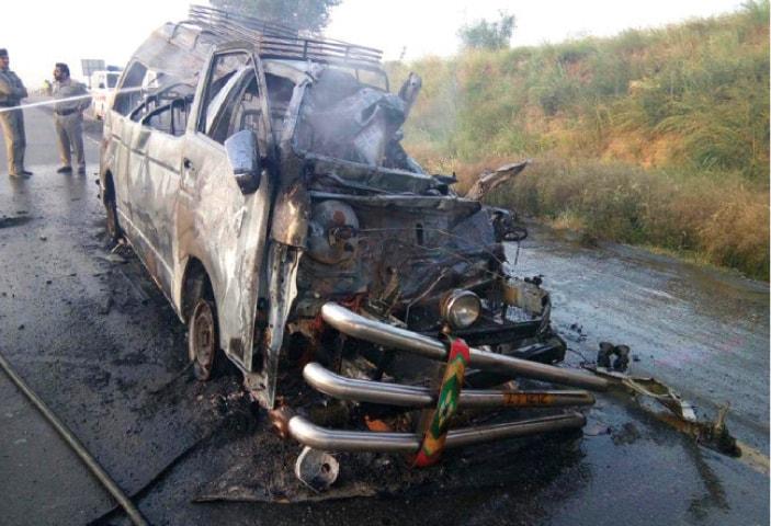 The smouldering wreckage of the passenger van. — Online