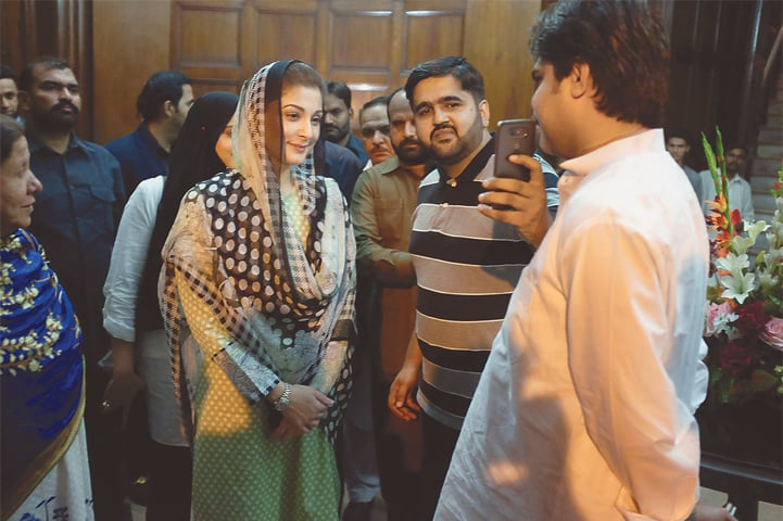 A PML-N supporter takes a selfie with Maryam Nawaz, the daughter of ousted prime minister Nawaz Sharif, at a rally on Saturday.—Reuters