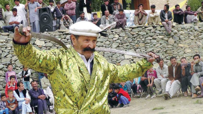 An artist performs sword dance at Nagar cultural festival. — Dawn
