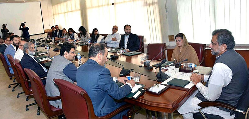 Prime Minister Shahid Khaqan Abbasi interacts with media representatives at the PM Office.—  APP