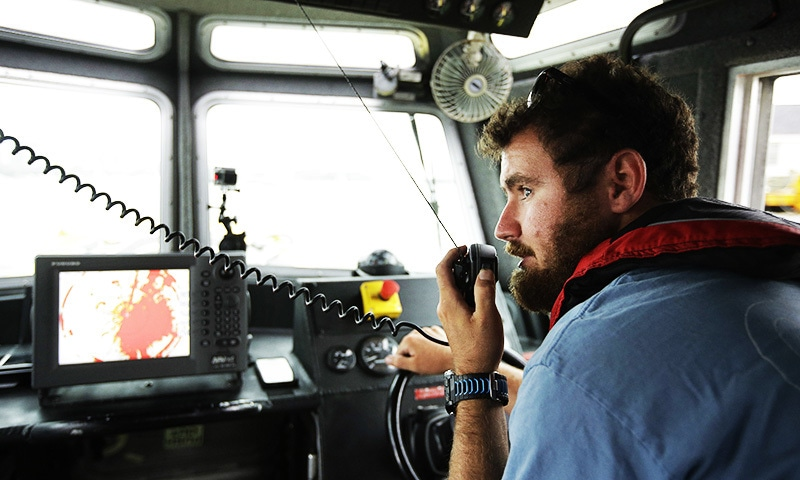 Jeff Gawrys, marine technician for Boston startup Sea Machines Robotics, prepares to disengage the navigation of a boat and switch the vessel over to fully autonomous control in Boston Harbor.—AP