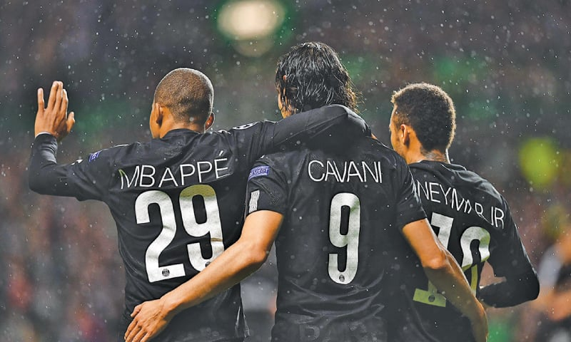 GLASGOW: Paris St Germain's (L to R) Kylian Mbappe, Edinson Cavani and Neymar celebrate after a goal during the Group 'B' encounter against Celtic.—AFP