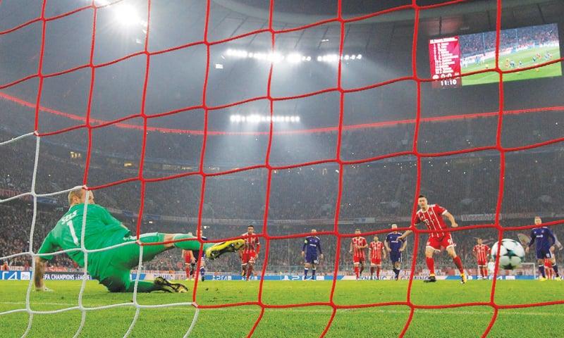 MUNICH: Bayern Munich's Robert Lewandowski scores on a penalty during their Champions League match against Anderlecht at the Allianz Arena.—Reuters