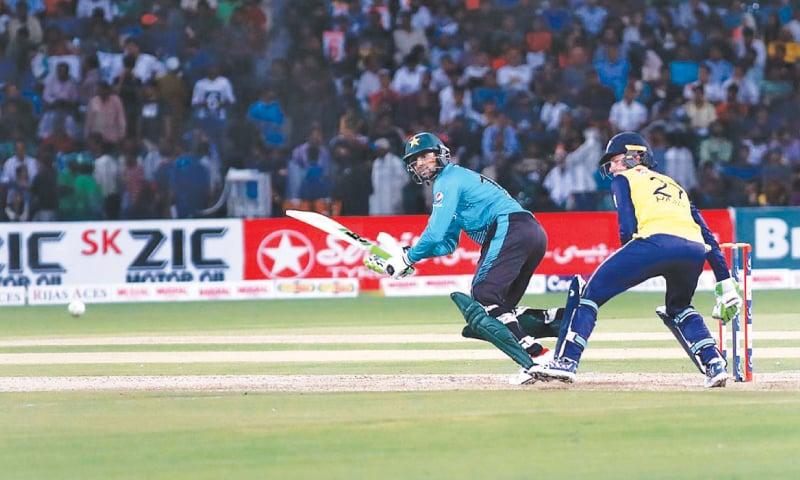 LAHORE: Pakistan batsman Shoaib Malik plays a shot.—APP