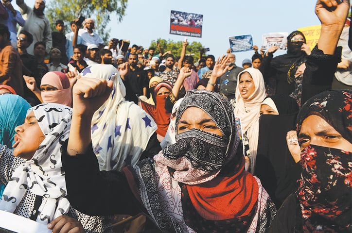 NEW DELHI: Demonstrators shout slogans during a protest against the persecution of Rohingya Muslims in Myanmar as they try to march on Myanmar's embassy here on Wednesday.—AFP