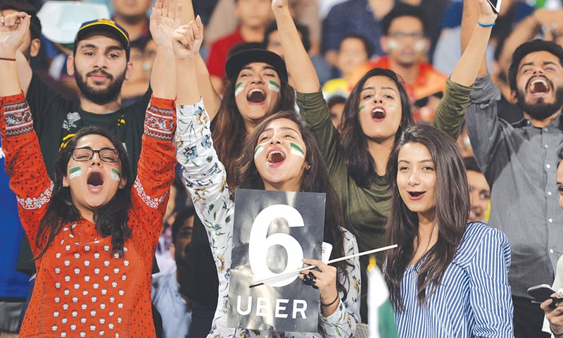LAHORE: Spectators hail a stroke during Pakistan's batting against the ICC World XI at the Gaddafi Stadium on Wednesday. The World XI won the second match of the three-game T20 series titled Independence Cup, defeating the hosts by seven wickets.—Murtaza Ali / White Star