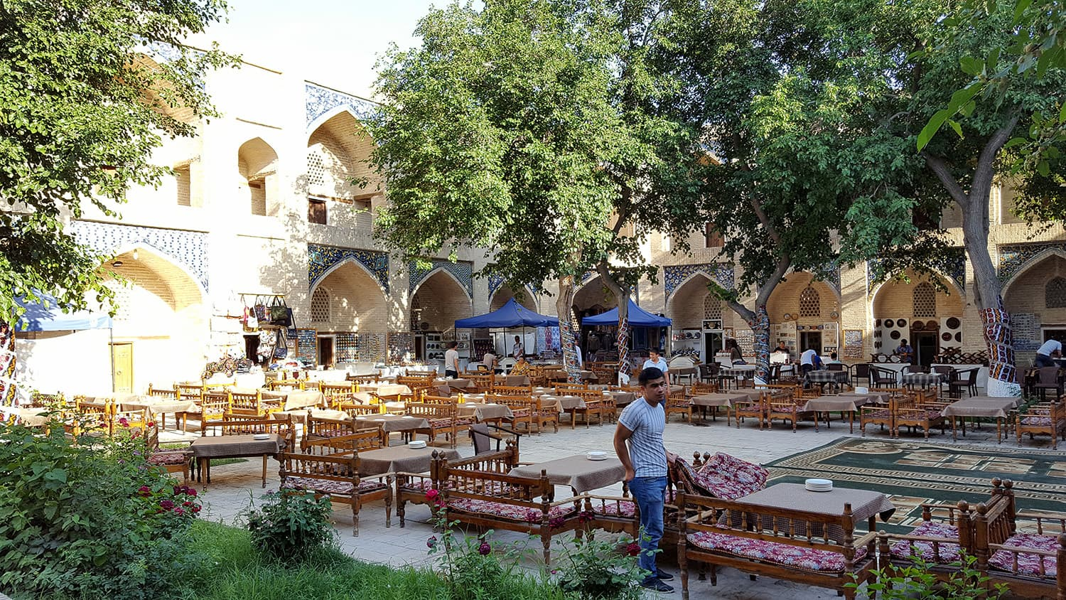 The courtyard of a madrassah in Bukhara converted into an open-air restaurant.