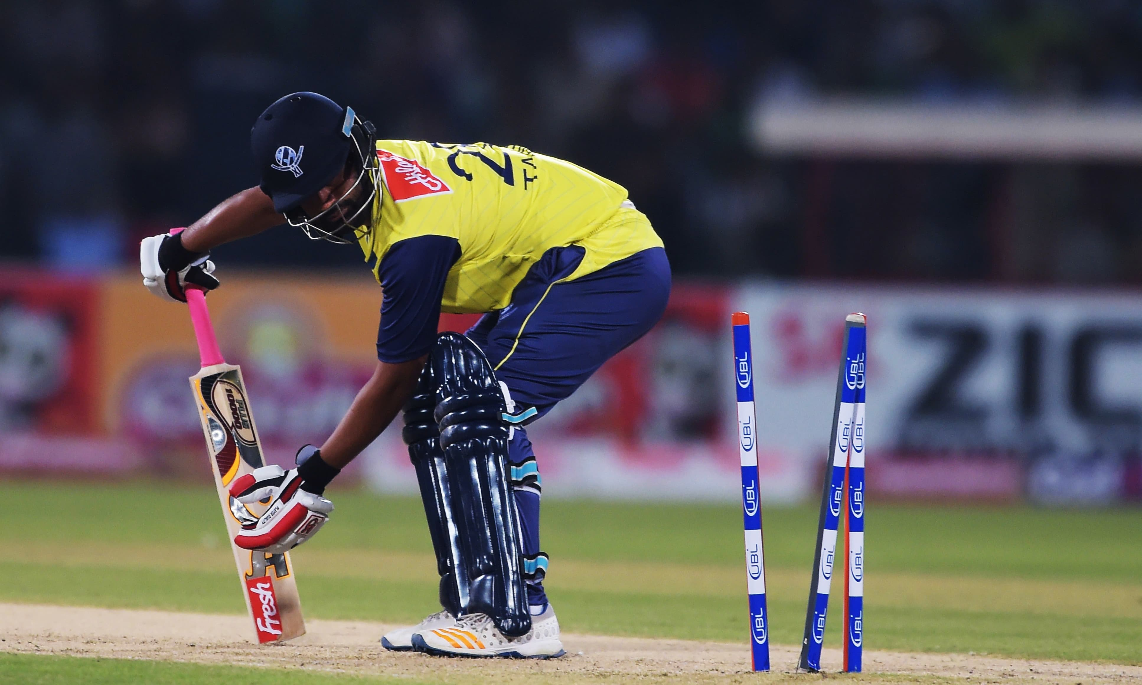World XI batsman Tamim Iqbal is bowled out by Usman Shinwari. ─ AFP