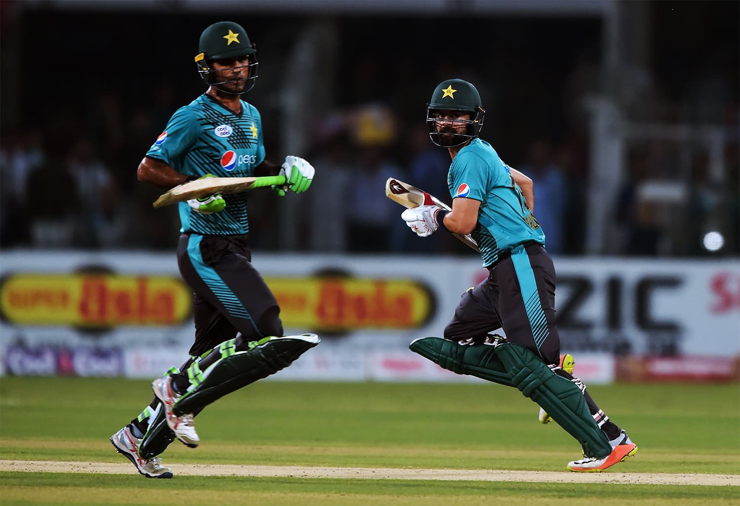 Babar Azam (L) and Ahmed Shehzad lead the batting chart. – AFP