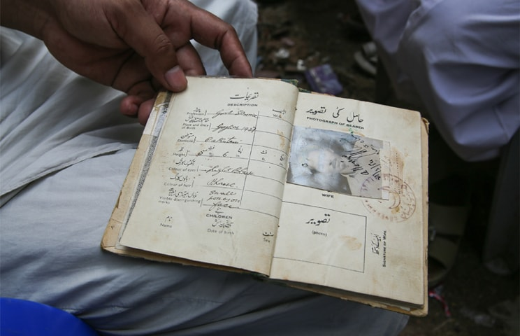 "a 1954 passport that was allegedly issued to a Rohingya elder, with the last line saying ""citizen of Pakistan"""