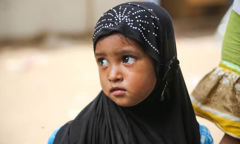 A young Rohingya girl leaves school for home in Burmi Colony in Karachi