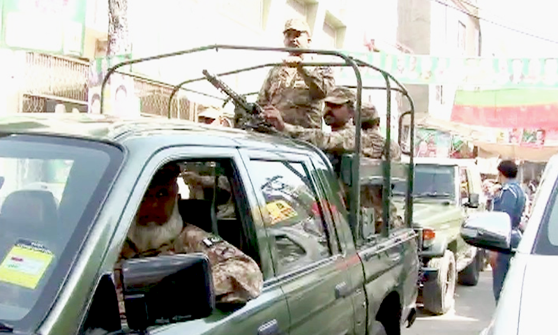 Army personnel patrol the NA-120 constituency. —DawnNews