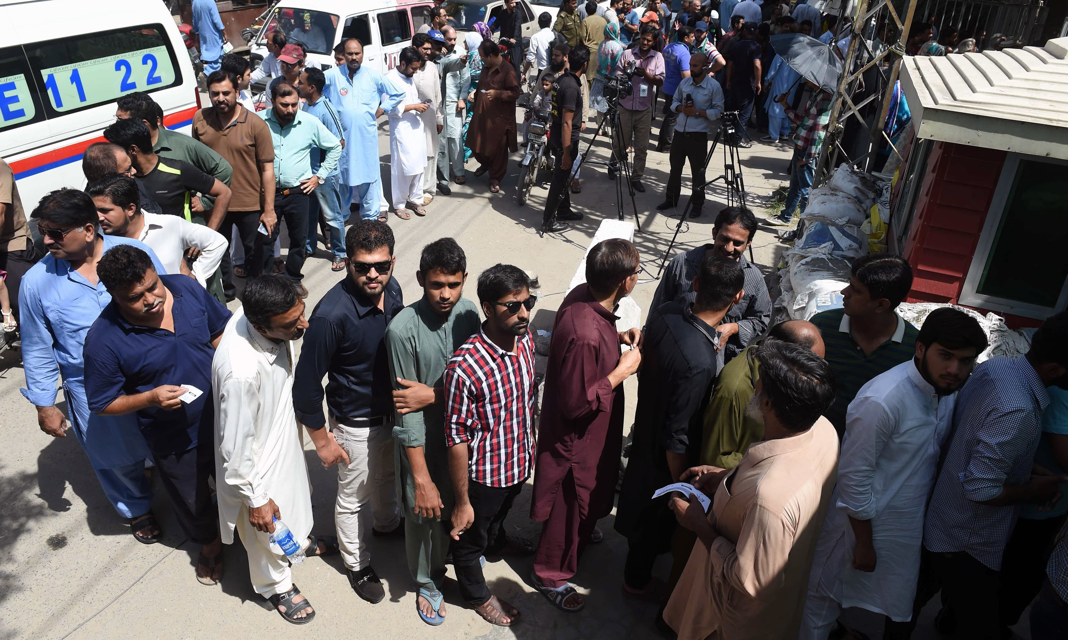 Voters queue to cast their ballots in a by-election in Lahore. —AFP
