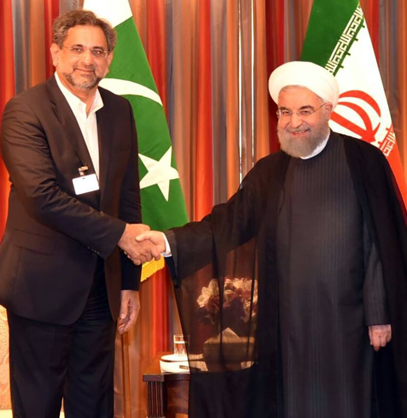 PM Abbasi meets Iranian President Hassan Rouhani.— PM Office