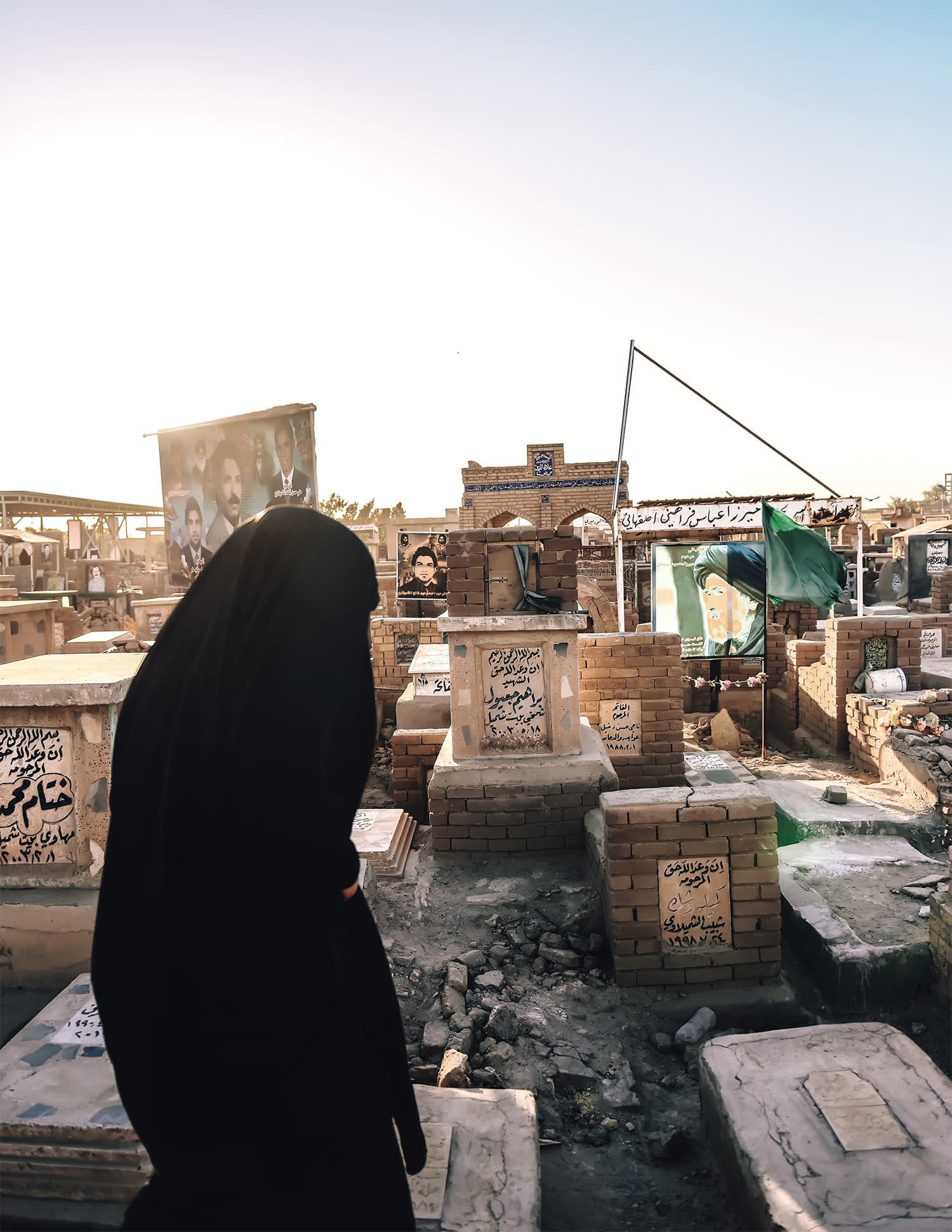 An Iraqi woman visits a relative's grave in Wadi-Al Salaam, which is said to contain over 5 million bodies.
