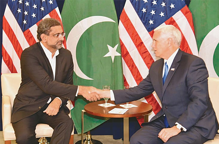 NEW YORK: Prime Minister Shahid Khaqan Abbasi shakes hands with US Vice President Michael Richard Pence before their meeting on the sidelines of the UN General Assembly on Tuesday.—Online