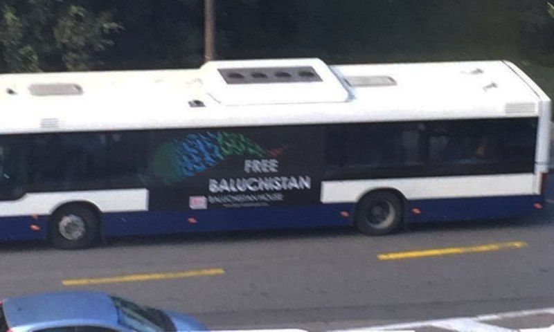 A bus in Rue de Ferney of Grand Sacconex with the &quot;Free Baluchistan&quot; poster on it.—<em>DawnNews</em>