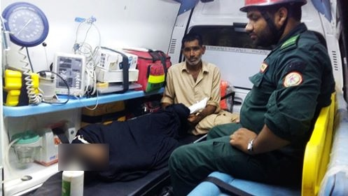 A victim of cross-border firing being given aid in an ambulance. ─ Photo by author