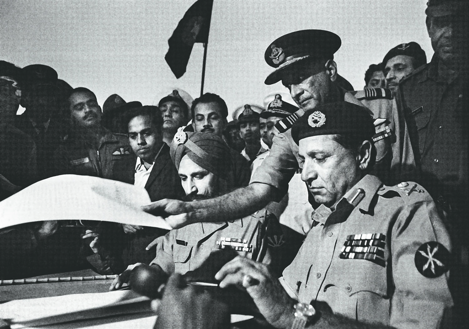 Lieutenant General Amir Abdullah Khan 'Tiger' Niazi (right), Head of the Eastern Command, signing the Treaty of Surrender on December 16, 1971. On the left is Lieutenant General Jagjit Singh Aurora, Joint Commander of the Bangladesh-India Allied Forces. | Photo: Raghu Rai