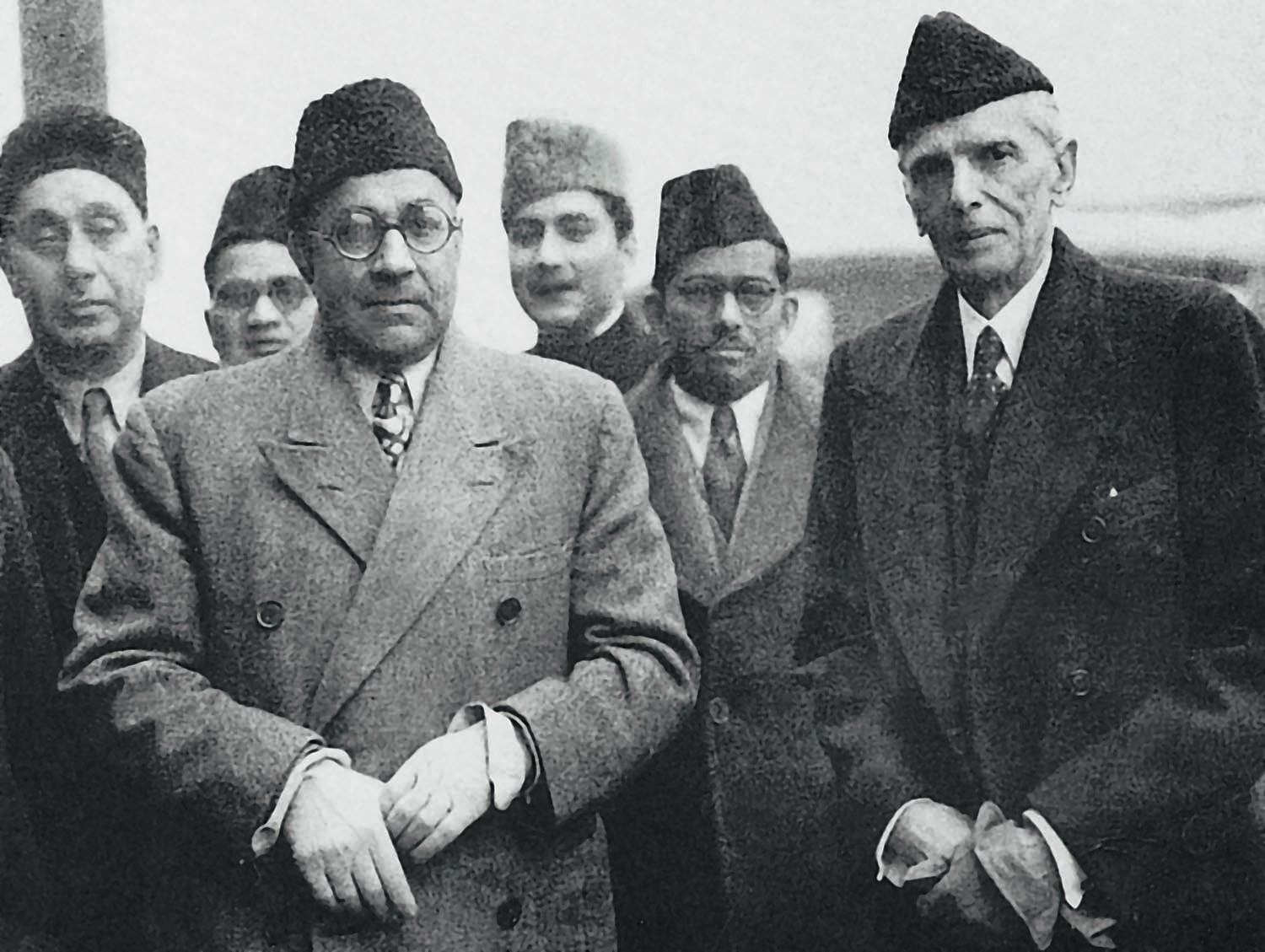 Quaid-i-Azam Mohammad Ali Jinnah (right) and Nawabzada Liaquat Ali Khan (left) during a trip to London in December 1946. In the centre is Altaf Husain, who at the time worked at Dawn Delhi and would later become the first editor of Dawn Karachi. | Photo: The Altaf Husain Family Collection