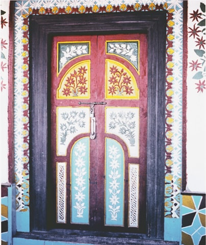 A richly decorated and inscribed door at the imam bargah of Goshoshal, Hopar, in upper Nagar. However, newer constructions built to increasingly urbanised tastes are devoid of the uninhibited, naive charm of folk culture | Photos from the book