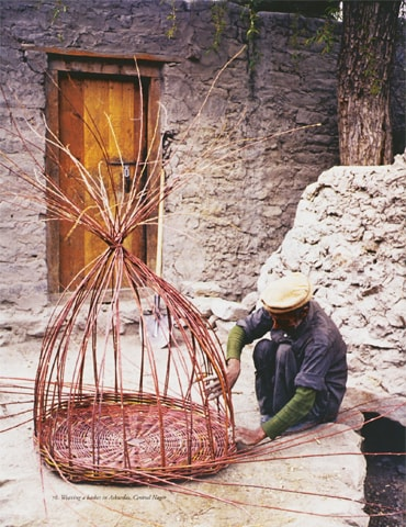 An elderly craftsman weaves a basket in Askurdas, central Nagar. The basketry season runs from March to early April. Twigs are cut from young willow trees and either woven immediately, or kept soaked in water, until needed, to ensure they remain supple