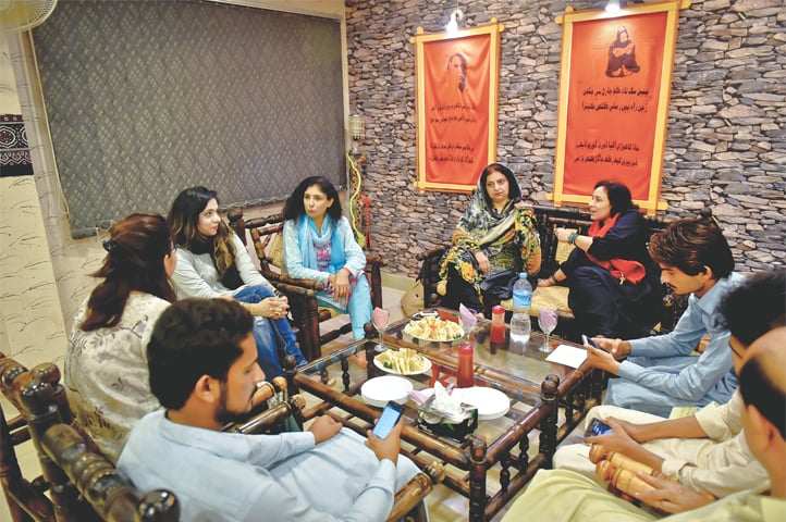 Intellectual discourse takes place over tea and snacks