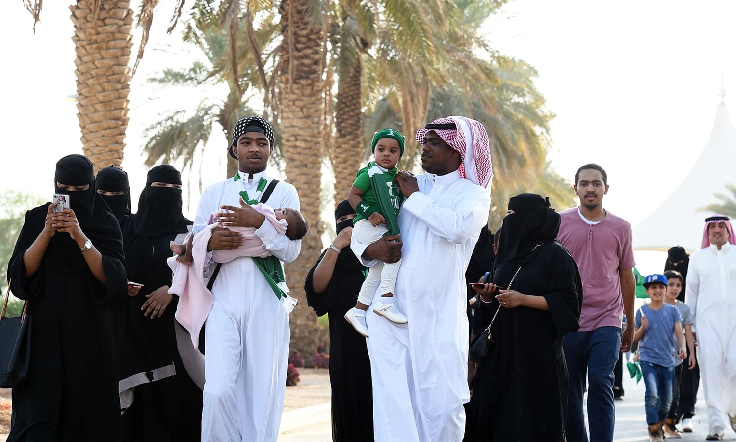 Saudi families arrive outside a stadium to attend an event in the capital Riyadh. — AFP