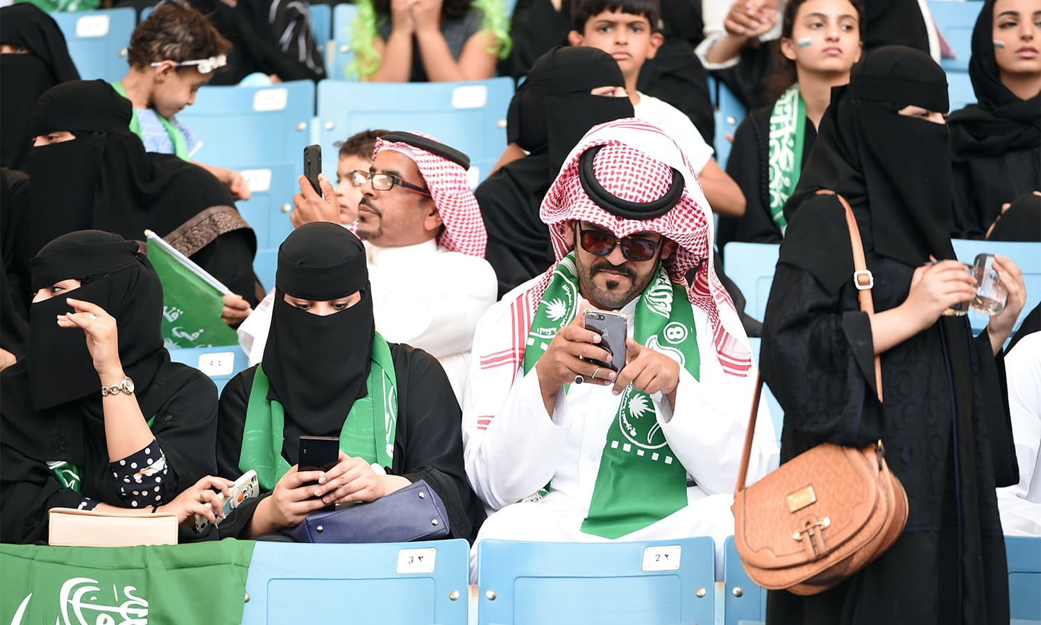 Saudi families sit in a stadium to attend an event in the capital Riyadh. — AFP