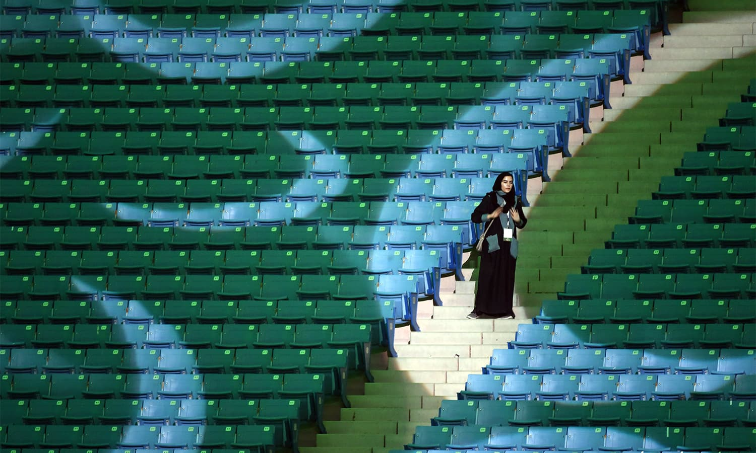 A Saudi woman arrives at a stadium to attend an event in the capital Riyadh. — AFP