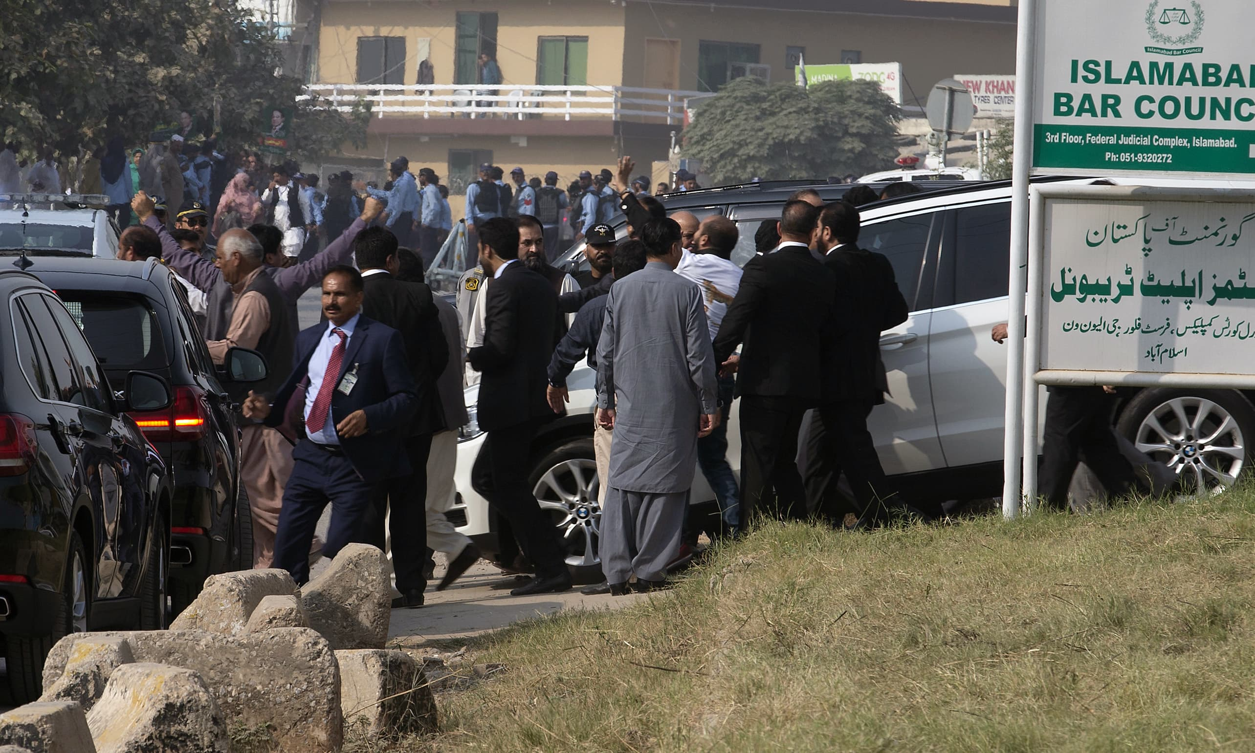 Nawaz Sharif leaves after appearing before the anti-corruption court in Islamabad. —AP