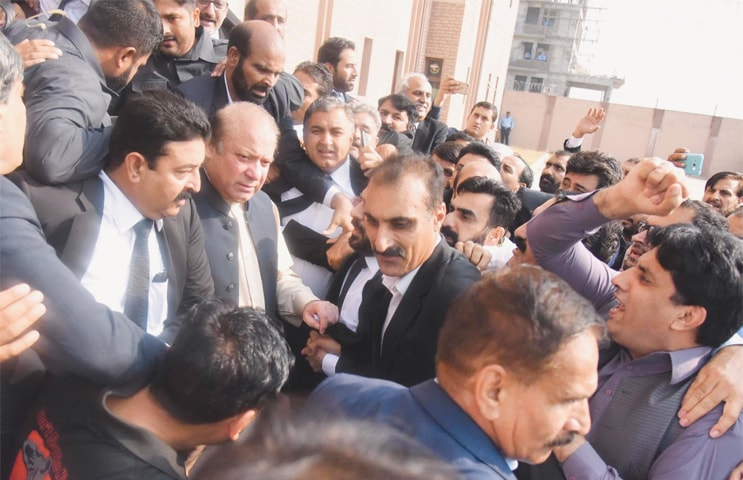 ISLAMABAD: Ousted prime minister Nawaz Sharif comes out of an accountability court after appearing before it on Tuesday in connection with three corruption references filed against him.—INP