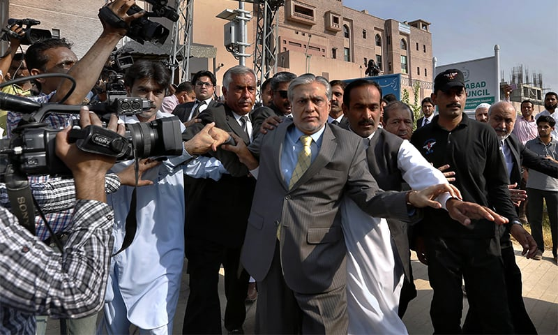 Finance Minister Ishaq Dar arrives to appear in an accountability court in Islamabad.— AP