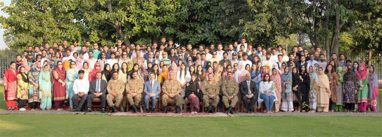 Chief of Army Staff Gen Qamar Javed Bajwa with officers and Baloch students. — ISPR
