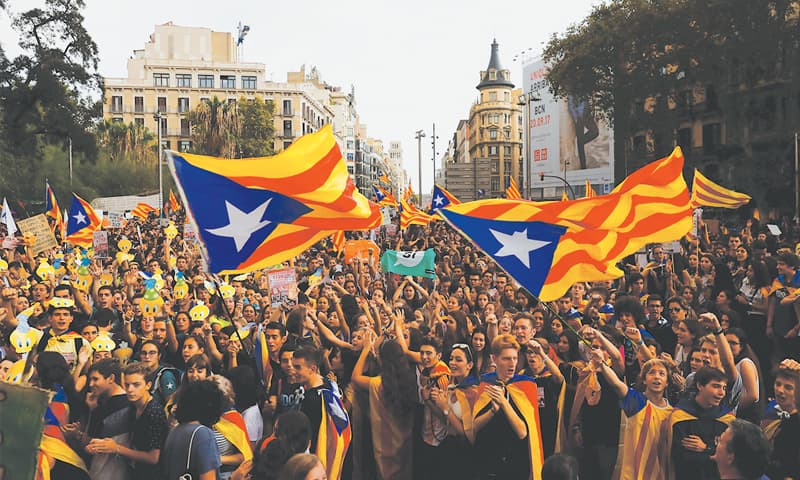 BARCELONA: Students attend a demonstration in favour of the banned Oct 1 independence referendum on Thursday.—Reuters
