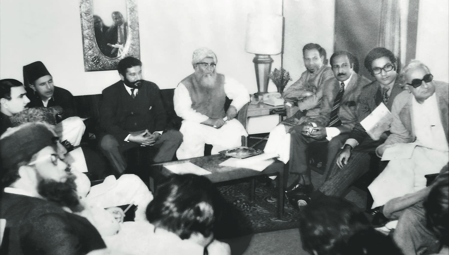 A meeting of the main opposition United Democratic Front at the Intercontinental Hotel in Rawalpindi ahead of the passage of the Constitution in 1973. Seen from left to right are: Maulana Shah Ahmed Noorani, Sardar Sherbaz Mazari, Nawabzada Nasrullah Khan, Syed Shah Mardan Shah Pir Pagaro, Maulana Mufti Mehmood, Professor Ghafoor Ahmed, Chaudhry Zahoor Elahi, Ahmed Raza Kasuri and Khan Abdul Wali Khan. | Photo: Sherbaz Mazari Archives