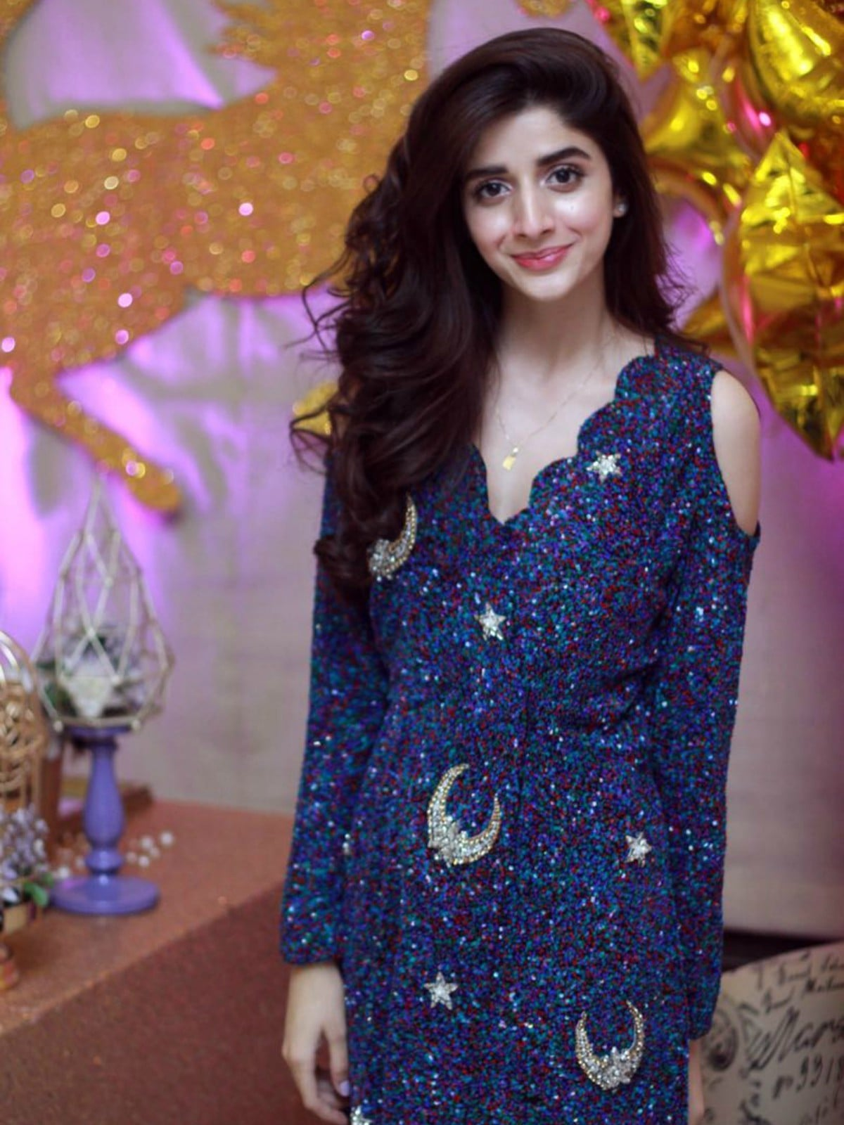Mawra's night sky-inspired dress is by Amira Haroon