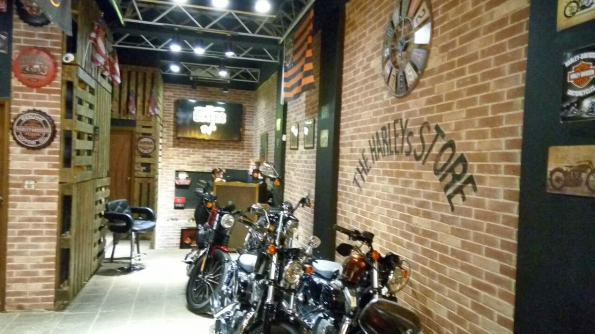 The cafe is below the Harley Store