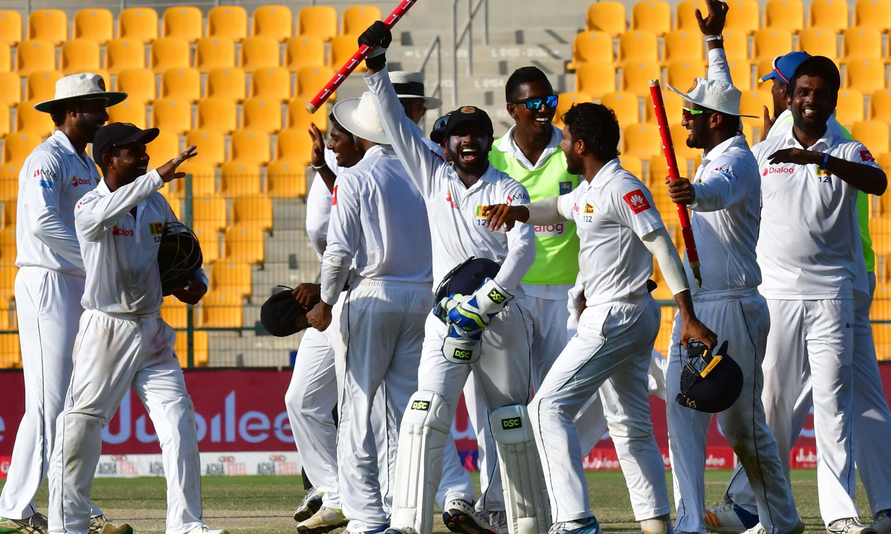 Sri Lankan cricketers celebrate after victory on the fifth day of the first Test cricket match between Sri Lanka and Pakistan at Sheikh Zayed Stadium in Abu Dhabi on October 2, 2017. —AFP