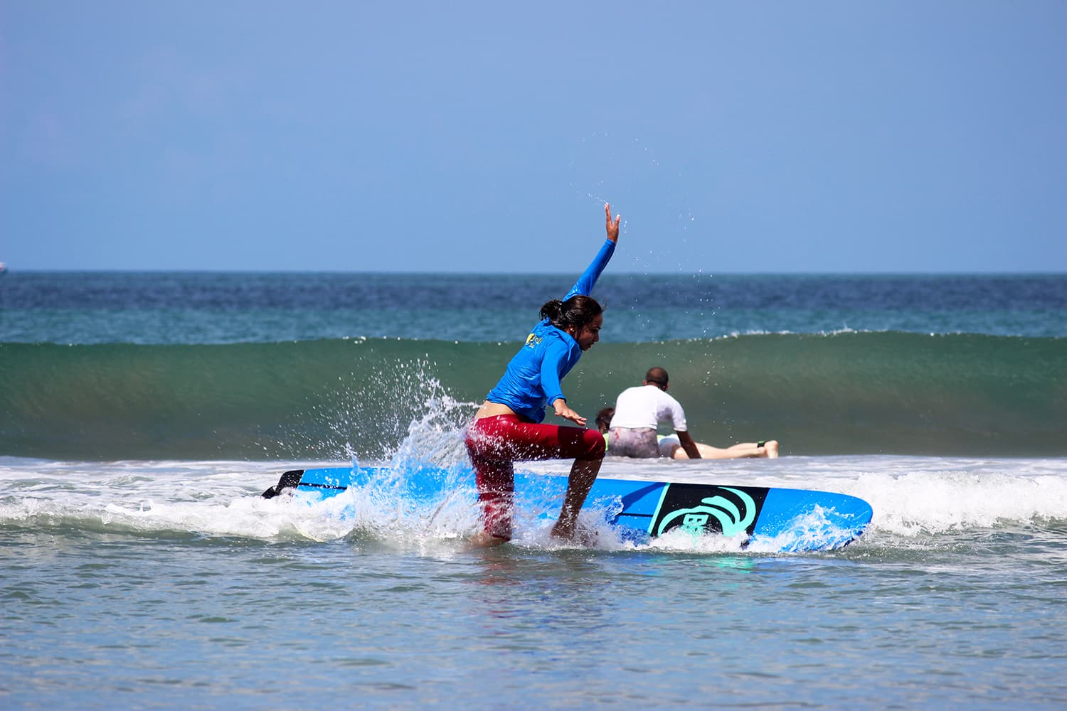 Taking a surfing lesson on Kuta Beach in Bali, Indonesia.