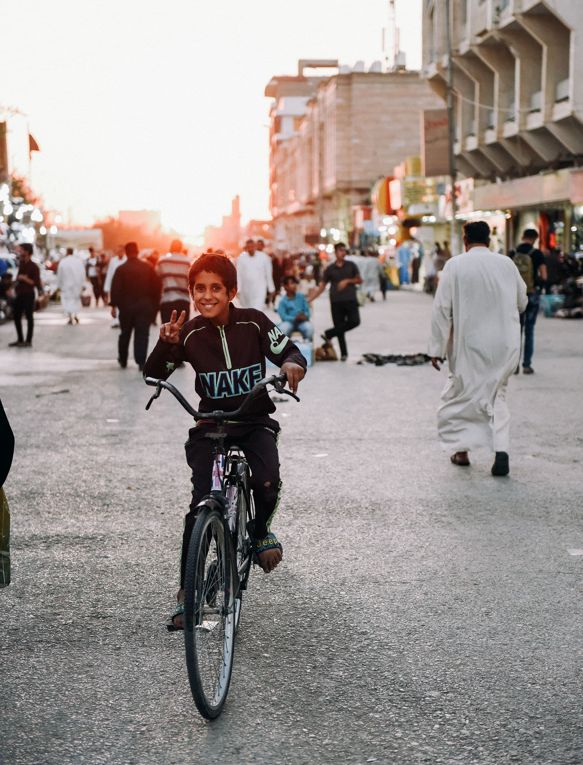 A boy strikes a pose in Najaf.