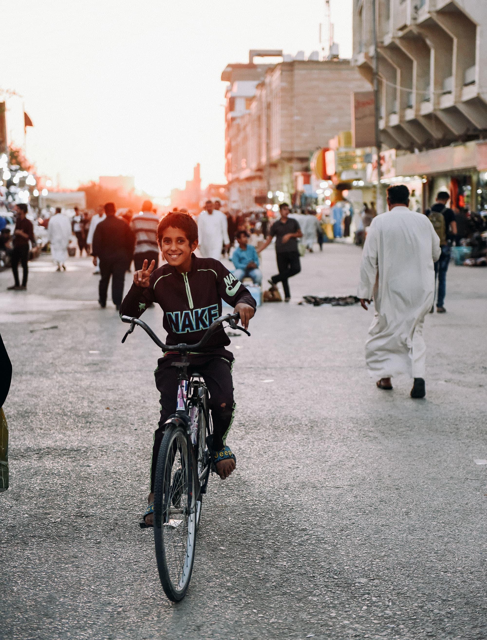 A boy strikes a pose in Najaf.