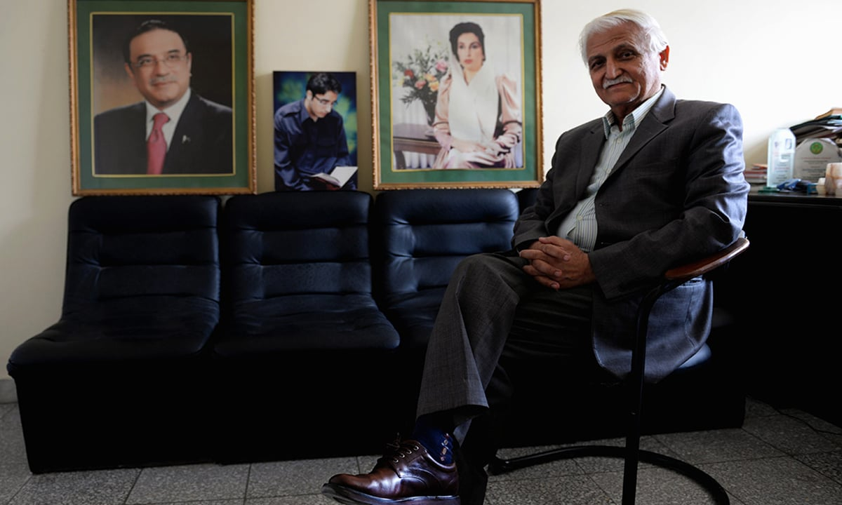 Babar sits next to framed pictures of Asif Ali Zardari, Bilawal Bhutto-Zardari and Benazir Bhutto | Mohammad Asim, White Star